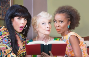 Diverse beautiful mature women reading a romance novel
