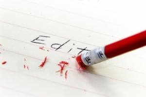 closeup of a pencil eraser correcting an error