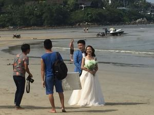 If you look closely, there's another bride posing in the jetski in the background