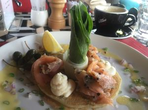 Spring onion blini with gravlax and sour cream
